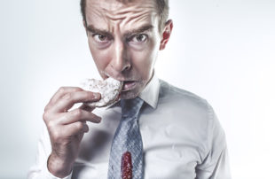 Man Eating Cookie - Time to Hire - Hiring Sales Reps